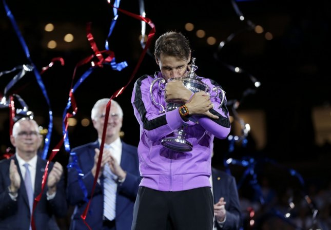 Rafael Nadal of Spain hugs the championship trophy after defeating Daniil Medvedev of Russia in 5 sets to win the Men's Final in Arthur Ashe Stadium at the 2019 US Open Tennis Championships at the USTA Billie Jean King National Tennis Center on Sunday in New York City. Photo by John Angelillo/UPI