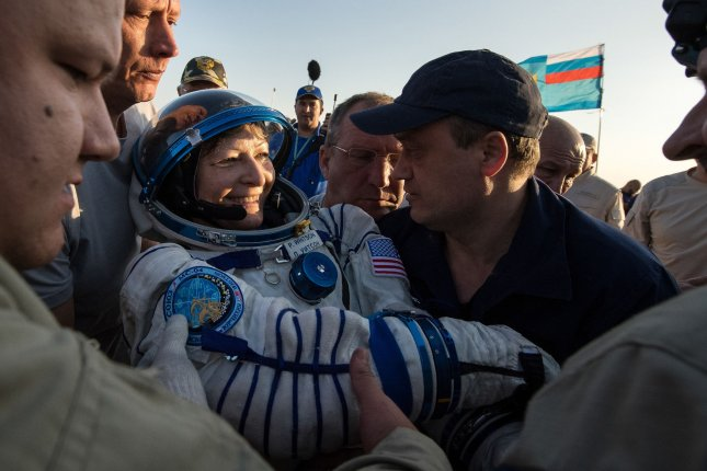 NASA astronaut Peggy Whitson is helped out of the Soyuz MS-04 spacecraft just minutes after she, Roscosmos cosmonaut Fyodor Yurchikhin and NASA astronaut Jack Fischer landed in a remote area near the town of Zhezkazgan, Kazakhstan, on September 3, 2017. Whitson turns 60 on February 9. File Photo by Bill Ingalls/UPI