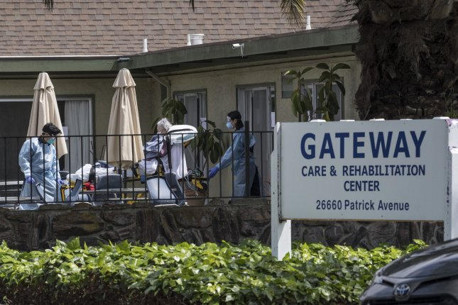 A patient is moved out of Gateway Care & Rehabillition Center, a skilled nursing facility in Hayward, Calif., on April 9. Representatives of U.S. nursing homes testified Thursday in Congress. File Photo by Terry Schmitt/UPI