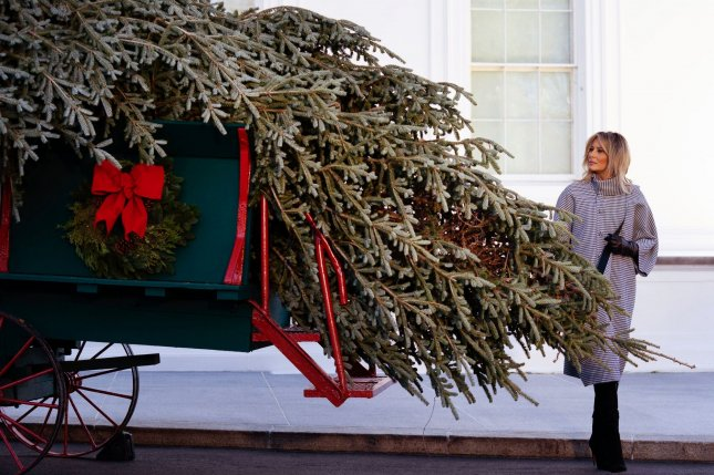 First lady Melania Trump received the official White House Christmas tree on Monday. Photo by Kevin Dietsch/UPI