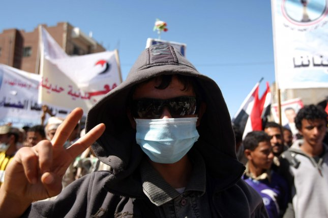 An anti-government protester attends a demonstration demanding the ouster of Yemen's President Ali Abdullah Saleh, in Sanaa November 13, 2011, a day after the United States said it was deeply troubled by reports of attacks on civilians in the Yemeni flashpoint city of Taez. UPI/ Abdulrahman Abdallah.