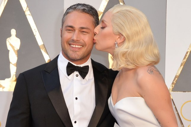 Lady Gaga (R) and Taylor Kinney at the Academy Awards on February 28. The couple split this month after five years of dating. File Photo by Kevin Dietsch/UPI
