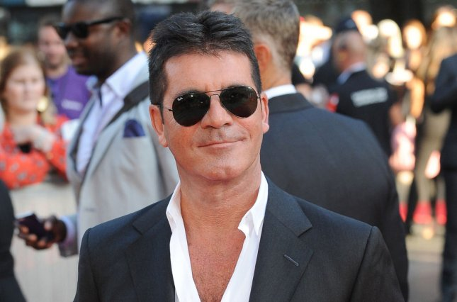 British music mogul Simon Cowell attends the world premiere of One Direction: This Is Us in London on August 20, 2013. File Photo by Paul Treadway/UPI