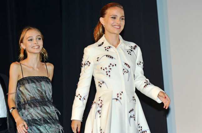 Natalie Portman (R) and Lily-Rose Depp walk onstage for cast introductions at the Toronto International Film Festival premiere of Planetarium in Canada on September 10, 2016. File Photo by Christine Chew/UPI