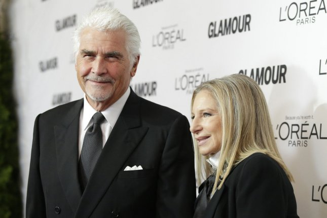 Barbra Streisand (R) and James Brolin at the Glamour Women of the Year Awards on November 11, 2013. File Photo by John Angelillo/UPI