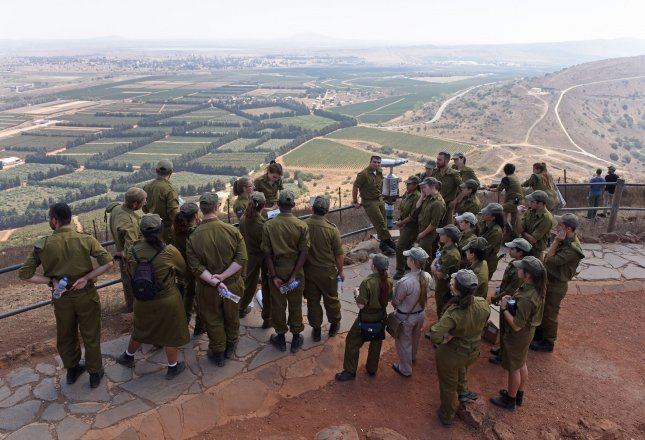 Israeli soldiers view the Israeli-Syrian border from Mount Bental overlooking the Golan Heights last year. File Photo by Debbie Hill/UPI