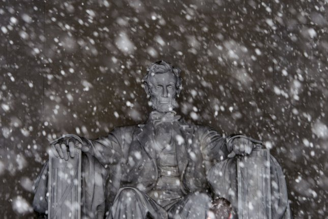 The Lincoln Memorial is seen as snow falls in Washington, D.C., on February 15, 2016. A President's Day On this day in 1922, the memorial was dedicated. File Photo by Kevin Dietsch/UPI