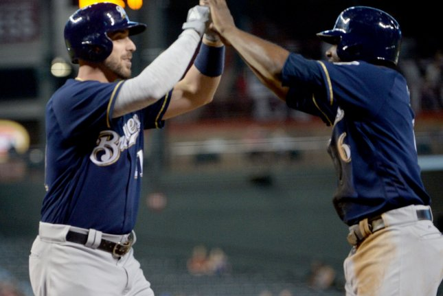 Milwaukee Brewers' Travis Shaw (L) is congratulated at home plate by Lorenzo Cain after Shaw hit a two run home run in the first inning against the Arizona Diamondbacks on May 16 at Chase Field in Phoenix. Photo by Art Foxall/UPI