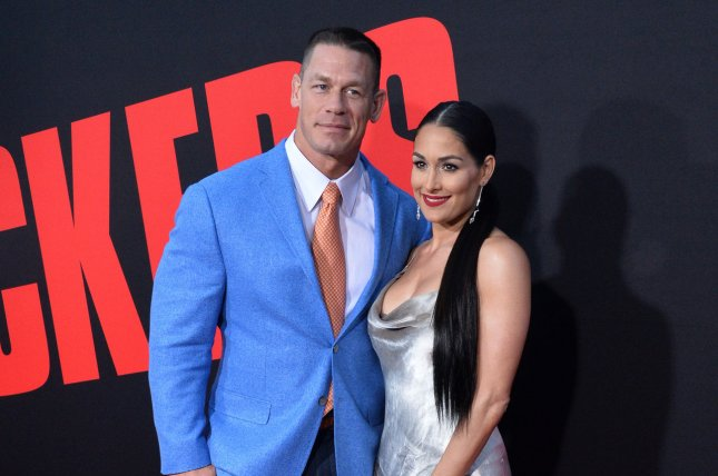 Nikki Bella (R), pictured with John Cena, vowed to never forget the wrestler in a post Thursday. File Photo by Jim Ruymen/UPI