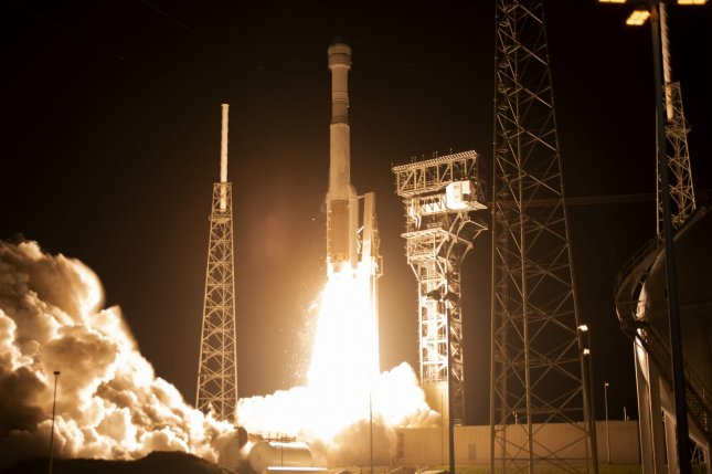 A United Launch Alliance Atlas V rocket launches an unmanned Boeing Starliner spacecraft from the Cape Canaveral Air Force Station, Fla., Friday. Photo by Joe Marino-Bill Cantrell/UPI