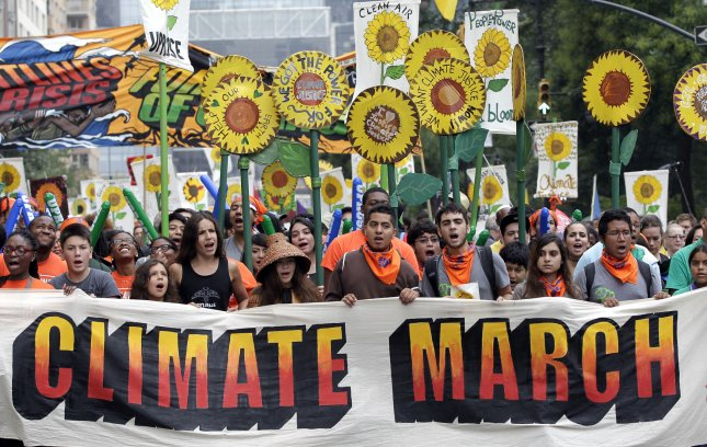 Participants approach 6th Avenue at the People's Climate March in New York City on September 21, 2014. File Photo by John Angelillo/UPI