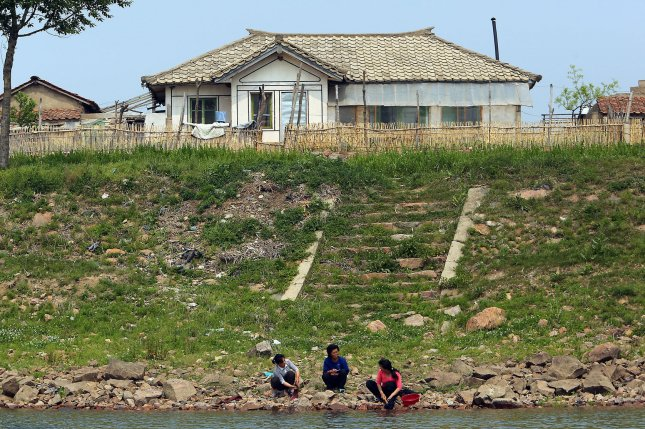 North Korea's Kim Jong Un instructed 14,000 stay-at-home mothers and wives to work in the fields of Yonbaek County, North Hwanghae Province, a former South Korean unification minister said Monday. File Photo by Stephen Shaver/UPI