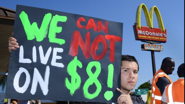 Fast food workers in the Los Angeles area began their first strike today, part of a nationwide attempt to raise the federal.minimum wage to $15 per hour and form a union. Organizers claim fast food workers ``are forced to rely on public assistance just to make ends meet.'' UPI/Jim Ruymen