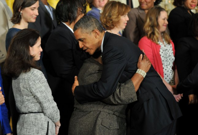 President Barack Obama hugs a member of a group of mothers who are for tougher gun laws after delivering remarks on gun violence during an event in the East Room at the White House on Thursday. UPI/Kevin Dietsch
