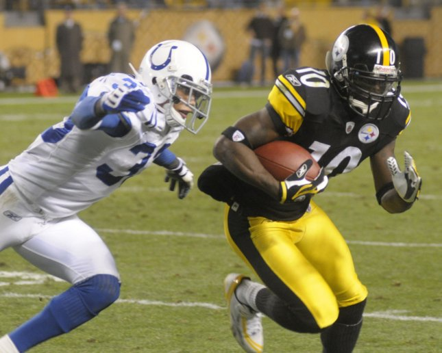 Indianapolis Colts Melvin Bullitt tackles Pittsburgh Steelers Santonio Holmes after a four yard gain in the fourth quarter of the Colts 24-20 win over the Pittsburgh Steelers at Heinz Field in Pittsburgh on November 9, 2008. (UPI Photo/Archie Carpenter)