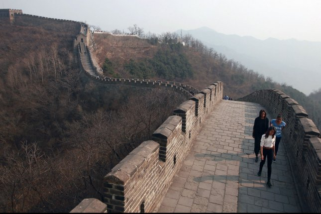 U.S. First Lady Michelle Obama and her two daughters Sasha (R ) and Malia (C ) visit the Mutianyu section of the Great Wall on the outskirts of Beijing on March 23, 2014. UPI/Stephen Shaver