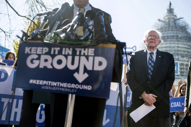 Sen. Bernie Sanders, I-Vt., at right, attends a press conference where he and Sen. Jeff Merkley, D-Ore., introduced the Keep it in the Ground Act -- a proposal to fight climate change by outlawing drilling for gas and oil on federal land -- in Washington, D.C., Wednesday, November 4, 2015. With little chance of passage in the Republican House, the law is intended as a grassroots effort to accelerate the transition to cleaner energy, Sanders and Merkley said. Photo by Kevin Dietsch/UPI