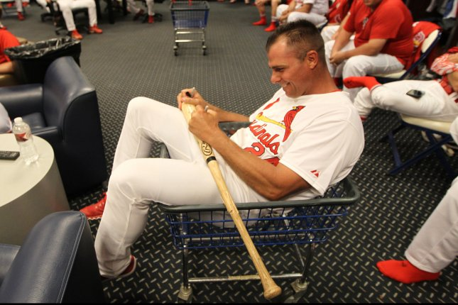 Former St. Louis Cardinals pitcher and outfielder Rick Ankiel signs a bat while sitting in a laundry cart during a meeting before the start of St. Louis Cardinals Fantasy Camp at Busch Stadium in St. Louis on June 25, 2016. Campers play baseball games in Busch Stadium for three days with former players as team members and coaches. Photo by Bill Greeenblatt/UPI