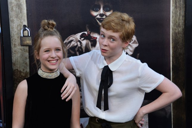 Cast members Lulu Wilson (L) and Sophia Lillis attend the premiere of the thriller Annabelle: Creation in Los Angeles on August 7. Photo by Jim Ruymen/UPI