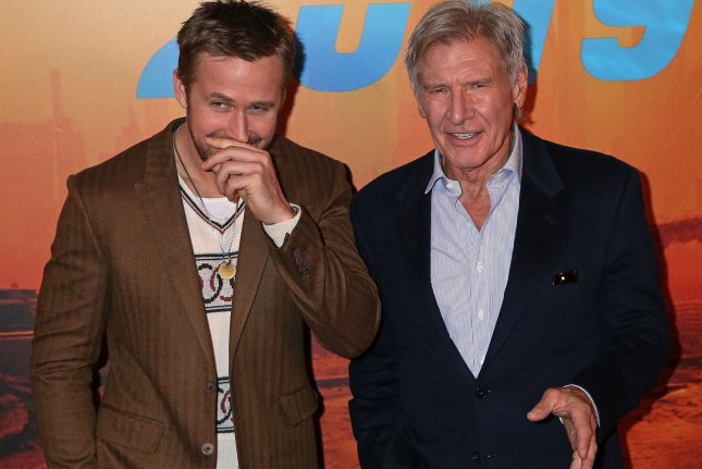 Ryan Gosling (L) and Harrison Ford attend a photocall for the film Blade Runner 2049 in Paris on September 20. Gosling hosted Saturday Night Live this weekend. Photo by David Silpa/UPI.