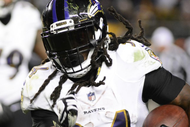 Baltimore Ravens running back Alex Collins (34) runs for the sidelines in the fourth quarter of the Pittsburgh Steelers 39-38 win on December 10 at Heinz Field in Pittsburgh. Photo by Archie Carpenter/UPI