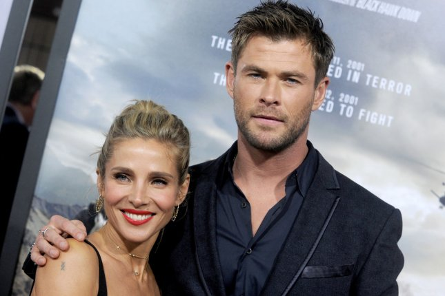 Chris Hemsworth (R), pictured with Elsa Pataky, gave daughter India a piggyback ride as he rode the waves Tuesday in Australia. File Photo by Dennis Van Tine/UPI
