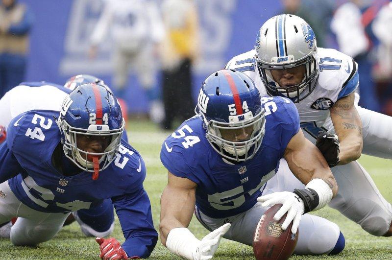 New York Giants cornerback Eli Apple watches Olivier Vernon recover a fumble. File photo by John Angelillo/UPI