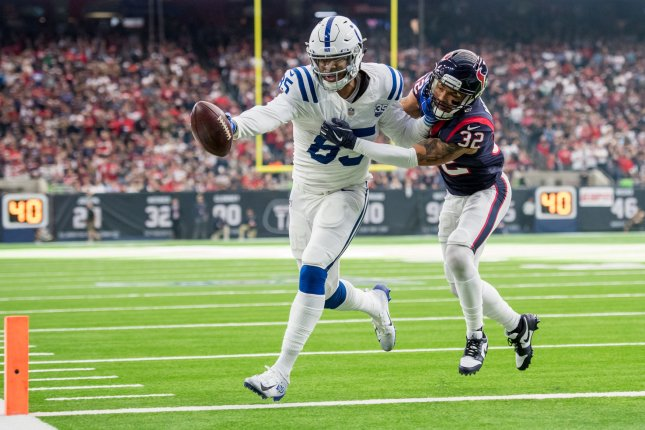 Indianapolis Colts tight end Eric Ebron (85) scores a touchdown while being defended by Houston Texans free safety Tyrann Mathieu in the first quarter of their Wild Card playoff game at NRG Stadium in Houston on January 5. Photo by Trask Smith/UPI