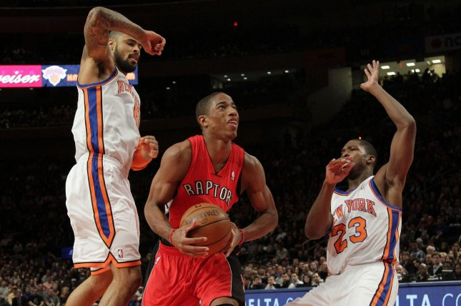 Toronto Raptors DeMar DeRozan drives the ball between New York Knicks Tyson Chandler and Toney Douglas in the first half at Madison Square Garden in New York City on January 2, 2012. UPI/John Angelillo