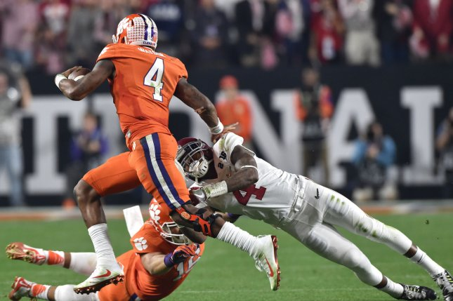 Researchers at Boston University say the accumulation of many smaller impacts contribute to the development of CTE more than number of concussions over many years of playing football. Pictured, Clemson Tigers quarterback Deshaun Watson, at left, eludes a tackle by Alabama safety Eddie Jackson in the third quarter of the 2016 College Football Playoff National Championship on January 11, 2016. File photo by Jon SooHoo/UPI