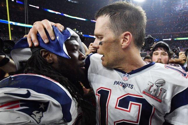 New England Patriots quarterback Tom Brady (R) hugs running back LeGarrette Blount after defeating the Atlanta Falcons in Super Bowl LI at NRG Stadium in Houston on Feb. 5. File photo by Kevin Dietsch/UPI