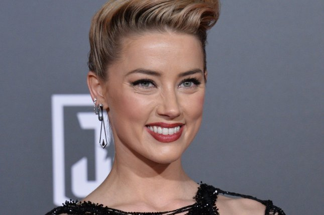 amber heard elon musk split again after brief reunion upi com