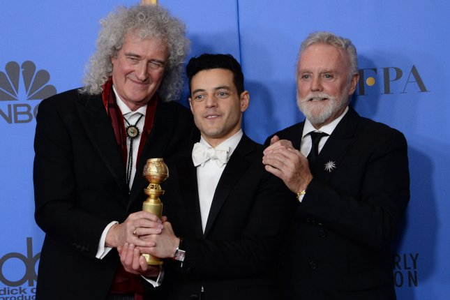 Left to right, Queen member Brian May, actor Rami Malek and Queen member Roger Taylor. Queen's video for Bohemian Rhapsody has reached over one billion views. File Photo by Jim Ruymen/UPI