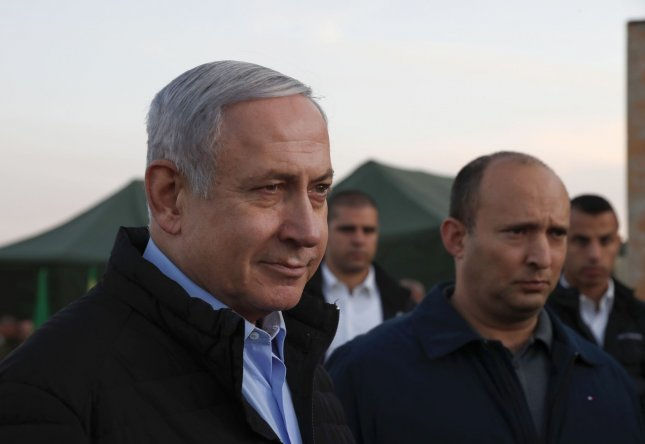Israeli prime minister Benjamin Netanyahu and his Defense minister, Naftali Bennet,  (R) toured an Israeli army base in the Golan Heights on the Israeli-Syrian border on Sunday. Pool Photo by Safadi/UPI