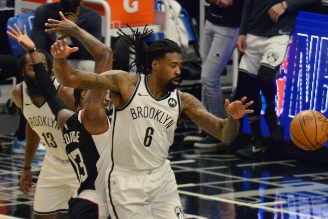 Brooklyn Nets center Deandre Jordan (6) fights for a loose ball during the second half of a win over the Los Angeles Clippers on Sunday in Los Angeles. Photo by Jim Ruymen/UPI