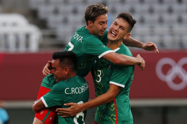 Mexico midfielder Sebastian Cordova (C) is lifted by teammates after scoring against France in a men's Group A match at the 2020 Summer Games on Thursday in Tokyo. Photo by Bob Strong/UPI