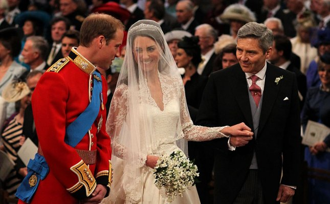 Prince William receives Kate Middleton from her father Michael Middleton during the Royal Wedding at Westminster Abbey in London on April 29, 2011. UPI/Dominic Lipinski/Pool