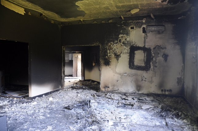 A burnt building is seen at the United States consulate, one day after armed men stormed the compound and killed the U.S. Ambassador Christopher Stevens and three others in Benghazi, Libya, on September 12, 2012. The U.S. Department of Justice said the complexities of the trial for the man accused of planning the attacks resulted in officials dismissing the possibility of the death penalty. File Photo by Tariq AL-hun/UPI
