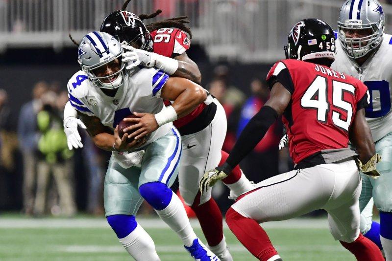 Atlanta Falcons defensive end Adrian Clayborn (99) sacks Dallas Cowboys quarterback Dak Prescott (4) for a 5-yard loss during the first half of an NFL game at Mercedes Benz Stadium on Sunday in Atlanta. Photo by David Tulis/UPI