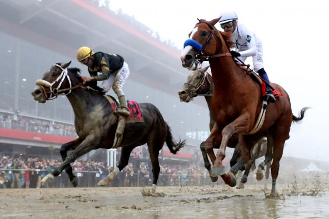 Justify, Mike Smith up, (right) wins the 143rd running of the Preakness Stakes on May 19, 2018 at Pimlico Race Course in Baltimore, Maryland. Photo by Mark Abraham/UPI