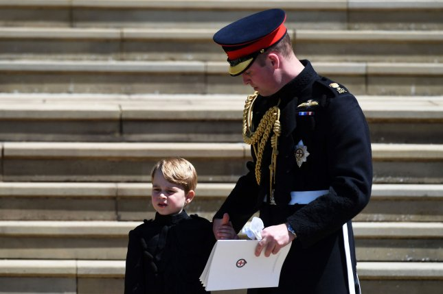 Prince George (L), pictured with Prince William, turned six years old Monday. File Photo by Neil Hall/UPI