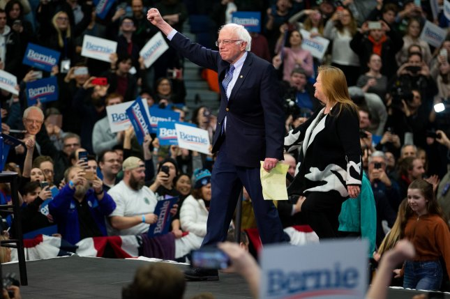 Vermont Sen. Bernie Sanders waves to supporters Tuesday night at Southern New Hampshire University in Manchester, N.H. Photo by Matthew Healey/UPI