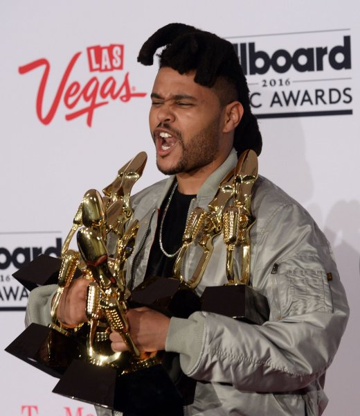 The Weeknd appears backstage with his eight awards during the annual Billboard Music Awards held at T-Mobile Arena in Las Vegas on May 22, 2016. The musician turns 30 on February 16. File Photo by Jim Ruymen/UPI