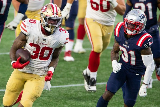 San Francisco 49ers running back Jeff Wilson Jr. (30) will miss at least his next three games due to a high-ankle sprain. File Photo by Matthew Healey/UPI