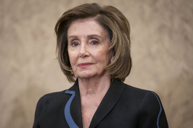 Speaker Nancy Pelosi, D-Calif., listens during a news conference at the U.S. Capitol on Wednesday. Pelosi announced a select committee to investigate the Jan. 6 attack on the Capitol. Photo by Sarah Silbiger/UPI
