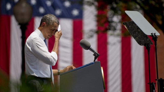 President Barack Obama wipes sweat from his face as he delivers remarks on climate change and new environmental standards, on the campus of Georgetown University on June 25, 2013 in Washington, D.C. UPI/Kevin Dietsch