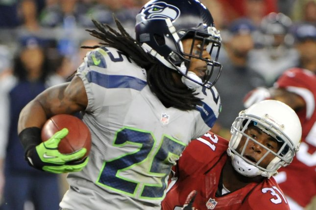 Seattle Seahawks Richard Sherman (L) tries to avoid a tackle by Arizona Cardinals Justin Bethel in the fourth quarter of the game at University of Phoenix Stadium in Glendale, Arizona on October 17, 2013. The Seahawks defeated the Cardinals 34-22. UPI/Art Foxall