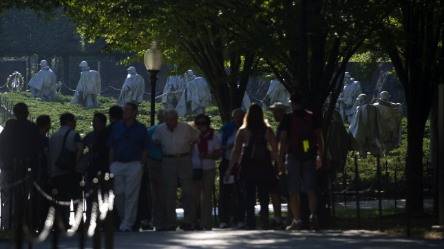 A group of tourist are turned away from the Korean War Memorial after it and other National Malls sites are closed, on October 2, 2013 in Washington, D.C. All national parks and memorials are closed due to the ongoing government shutdown. UPI/Kevin Dietsch