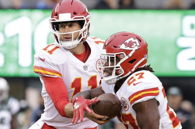 Kansas City Chiefs quarterback Alex Smith hands the football off to running back Kareem Hunt in the second half against the New York Jets in week 13 of the NFL season at MetLife Stadium in East Rutherford, New Jersey on December 3, 2017. File photo by John Angelillo/UPI
