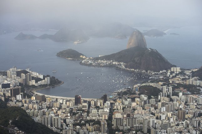 Copacabana Beach and the surrounding area is seen from the Christ the Redeemer Statue, Rio De Janeiro, Brazil. Exxon and Norwegian major Equinor close a deal to establish a partnership at an oil basin off the nation's coast. File Photo by Kevin Dietsch/UPI